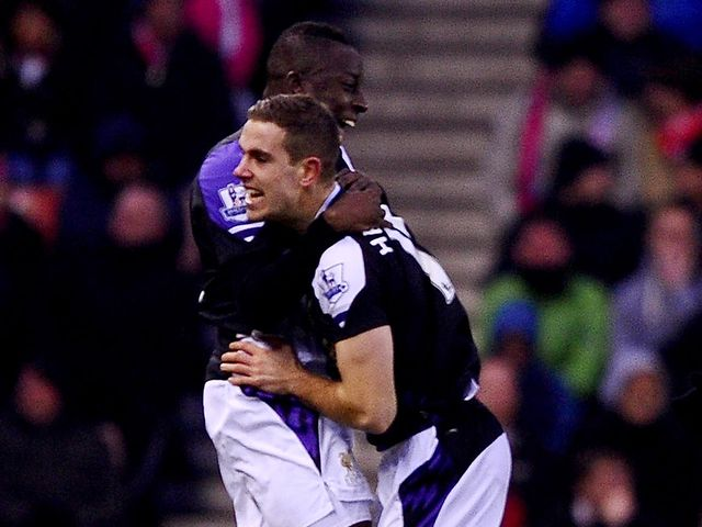Aly Cissokho celebrates Liverpool's opener with Jordan Henderson