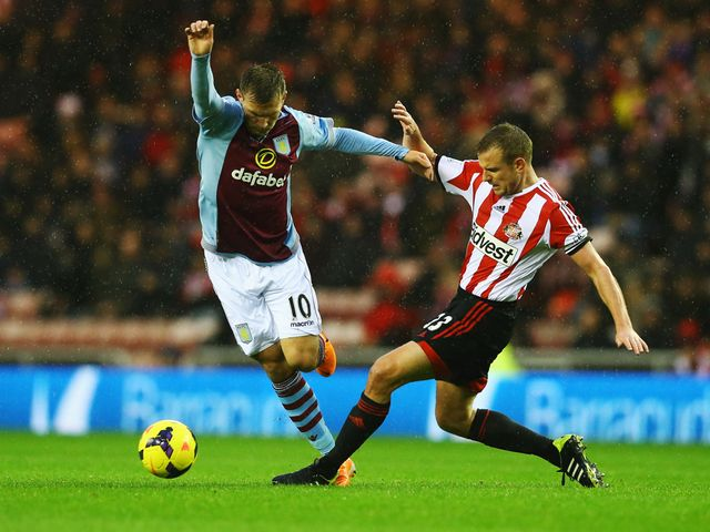 Andreas Weimann avoids Lee Cattermole