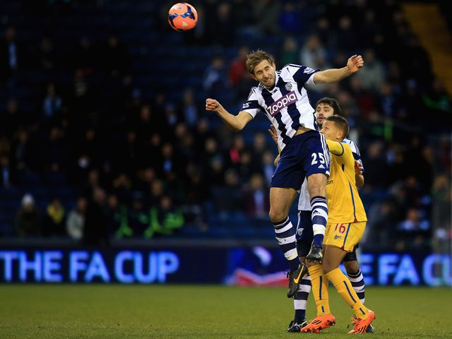 West Brom's Craig Dawson heads clear at The Hawthorns