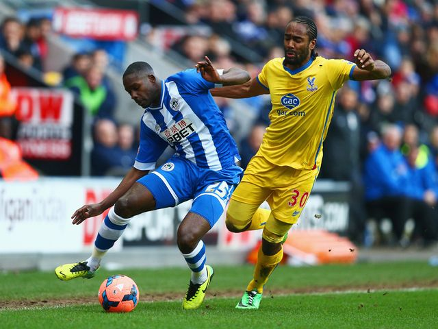 Leon Barnett keeps the ball away from Cameron Jerome