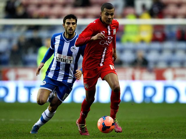 Dele Alli holds off Jordi Gomez
