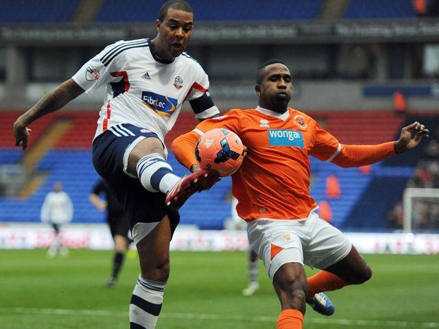 Bolton's Zat Knight and Ricardo Fuller of Blackpool do battle