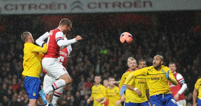 Lukas Podolski: Notched a brace before Coventry rallied in the second period