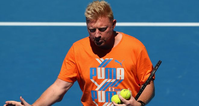 Boris Becker on court in Melbourne helping Novak Djokovic
