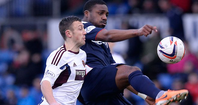 Dale Carrick of Hearts and Yann Songo'o in action at Dingwall
