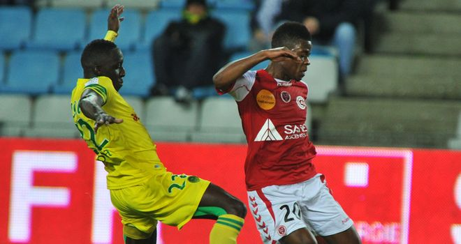 Nantes' Issa Cissokho challenges Floyd Ayite of Riems