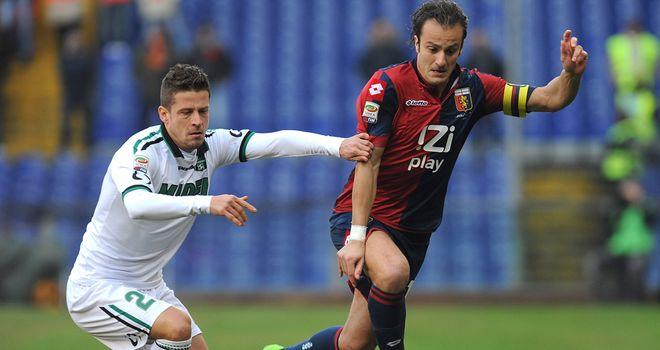 Marcello Gazzola keeps track of Alberto Gilardino
