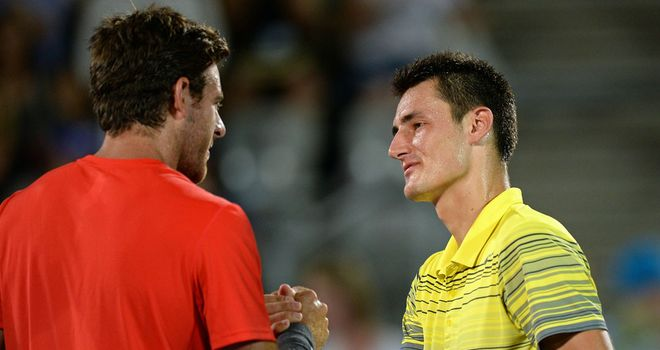 Juan Martin del Potro (l) shakes hands with Bernard Tomic following their one-sided Sydney final on Saturday