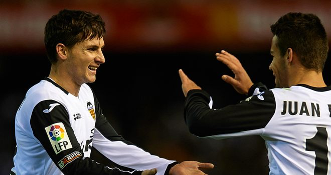 Pablo Piatti (left) of Valencia celebrates after scoring