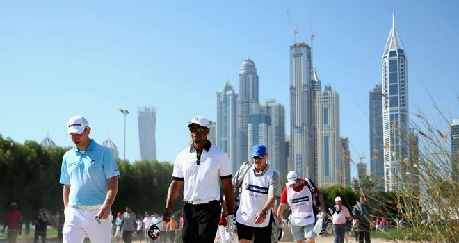 Stephen Gallacher (L) with Tiger Woods during the Champions Challenge in Dubai