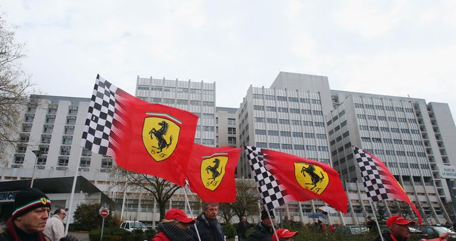 Ferrari fans pay tribute to Schumacher outside the hospital