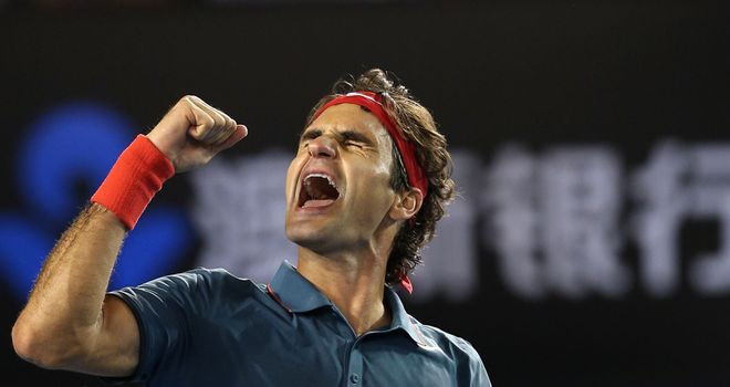 Roger Federer celebrates an emotional victory