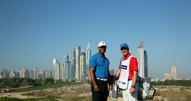 Tiger Woods poses with caddie Joe LaCava at the Emirates GC in Dubai