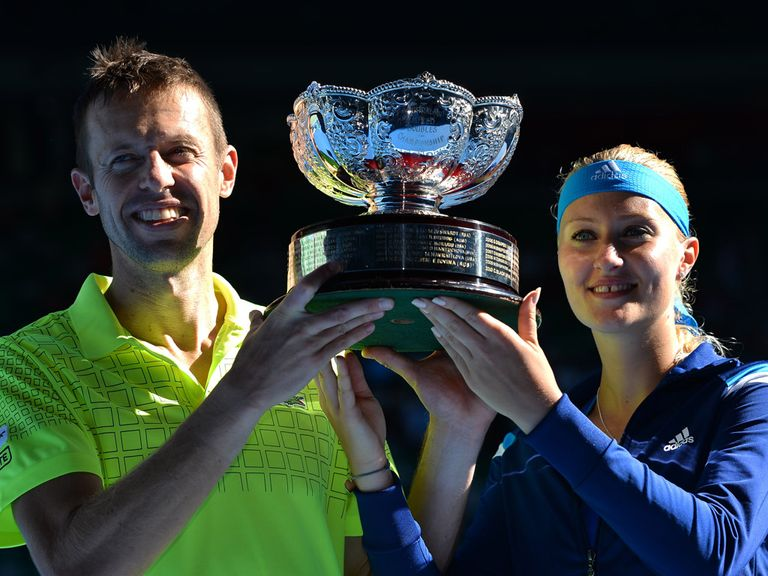Nestor and Mladenovic pose with the mixed doubles trophy