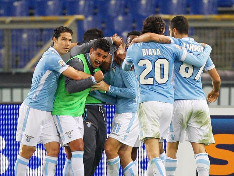 Lazio players mob Miroslav Klose after his late goal