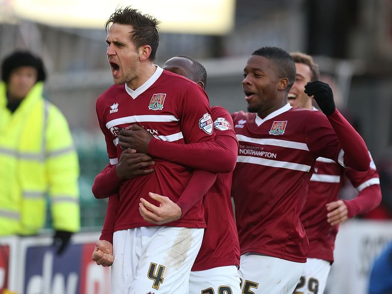Northampton's Darren Carter celebrates after scoring his side's second