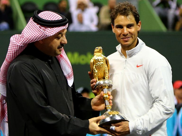 Nadal collects the trophy in Doha