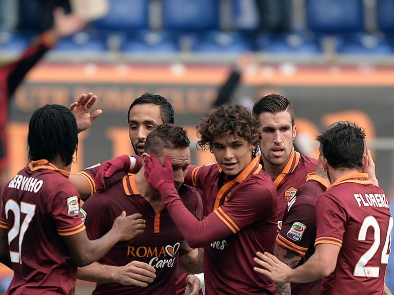 Francesco Totti is congratulated by Roma teammates