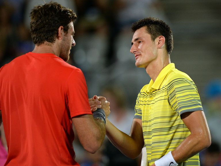 Juan Martin del Potro (l) shakes hands with Bernard Tomic following their one-sided final
