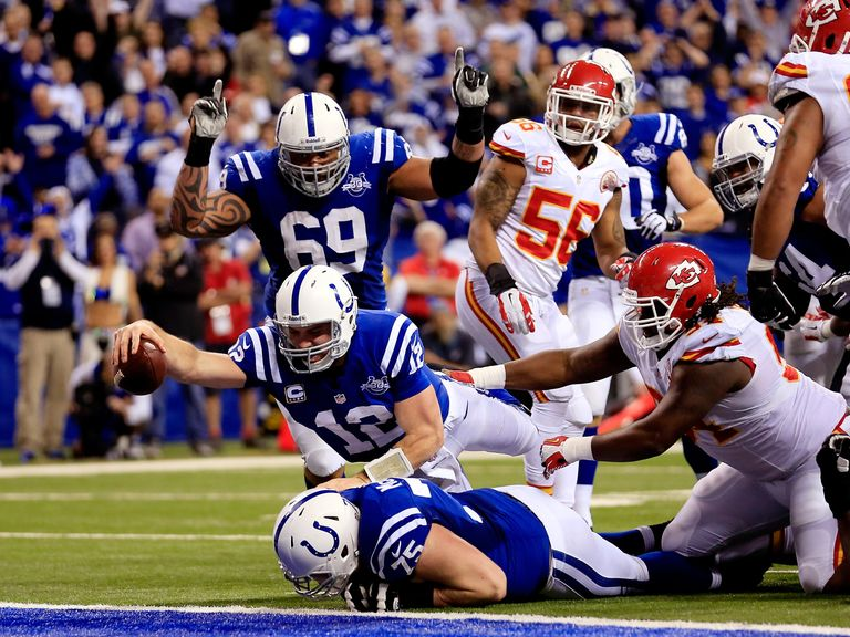 Andrew Luck reaches out to score a touchdown