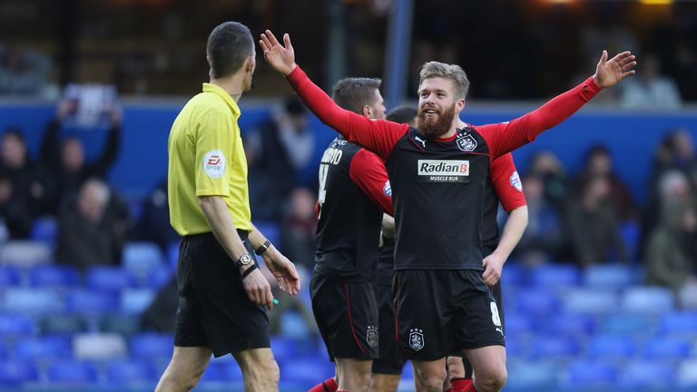 Adam Clayton: Celebrates scoring Huddersfield's second