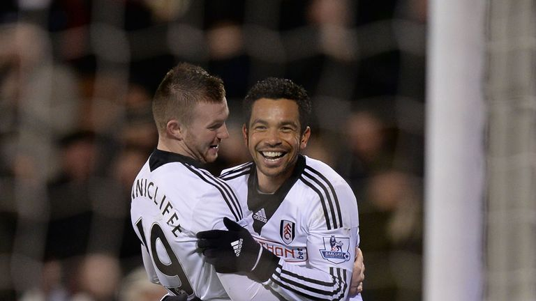 Richardson: the midfielder (R) is determined to help Fulham to safety
