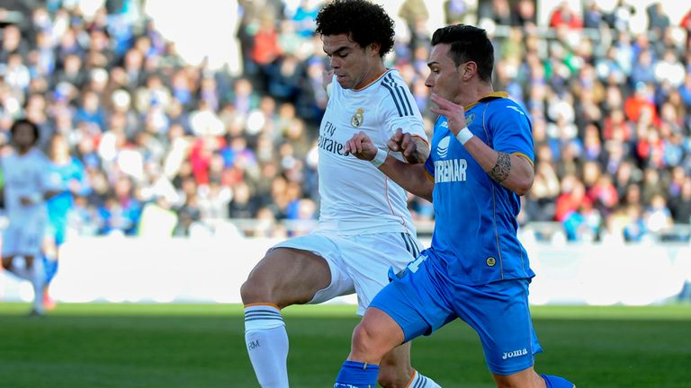 Real Madrid's defender Pepe vies with Getafe's Adrian Colunga