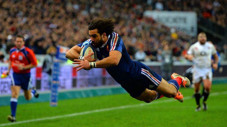 Yoann Huget of France dives in to score his second try