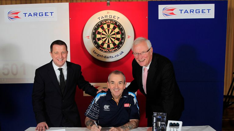 Phil Taylor: signs lucrative new deal alongside Target MD Garry Plummer and manager Barry Hearn