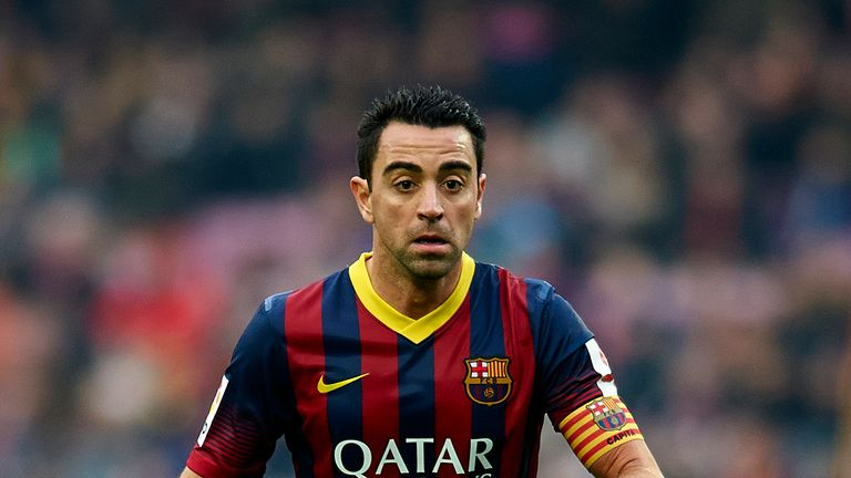 Xavi partners former Barcelona team-mate Andres Iniesta in midfield