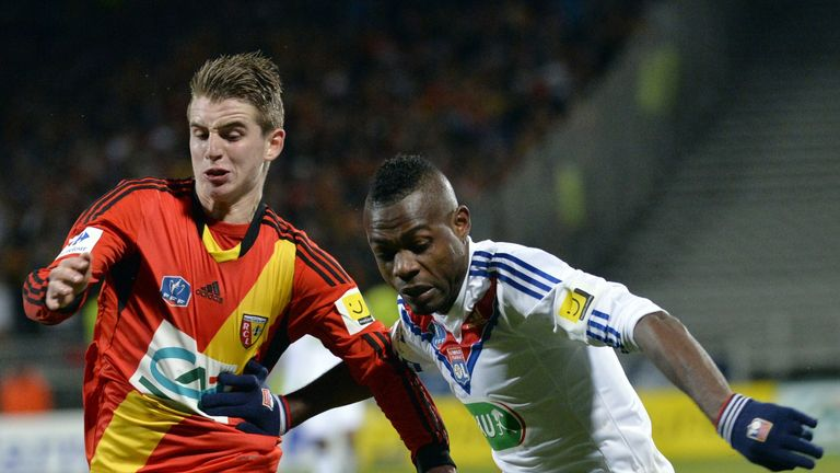 Lens' Benjamin Bourigeaud (left) vies with Henri Bedimo NSame