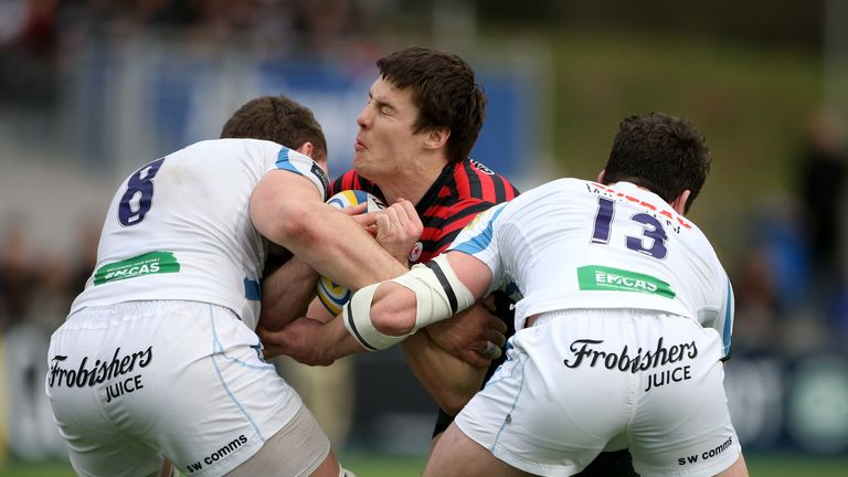 Big impact: Joel Tomkins is tackled by Dave Ewers and Ian Whitten