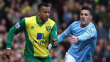 Martin Olsson: Holds off Stevan Jovetic at Carrow Road