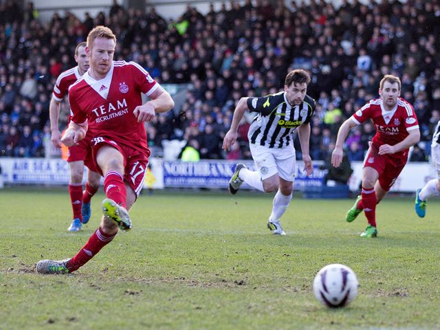 Adam Rooney strokes home Aberdeen's winning penalty