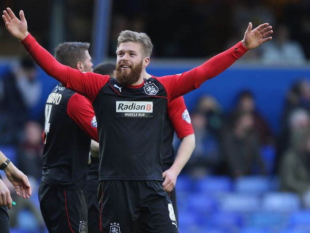 Adam Clayton celebrates his Huddersfield goal