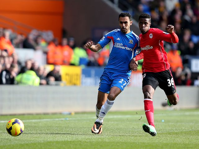 Ahmed El Mohamady of Hull battles with Wilfried Zaha of Cardiff