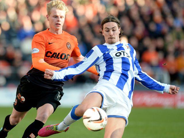 Gary Mackay-Steven battles with Kilmarnock's Jackson Irvine
