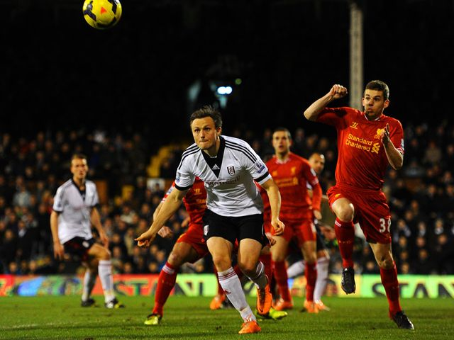 William Kvist and Jon Flanagan battle for the ball