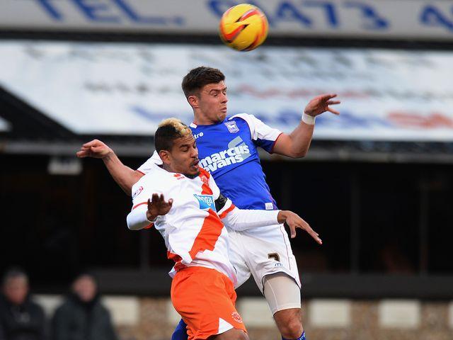 Aaron Cresswell of Ipswich Town challenges Fari Haroun of Blackpool