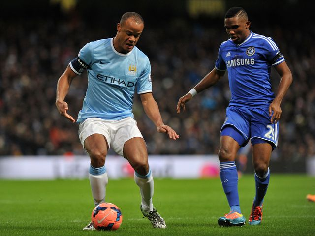 Vincent Kompany vies with Samuel Eto'o