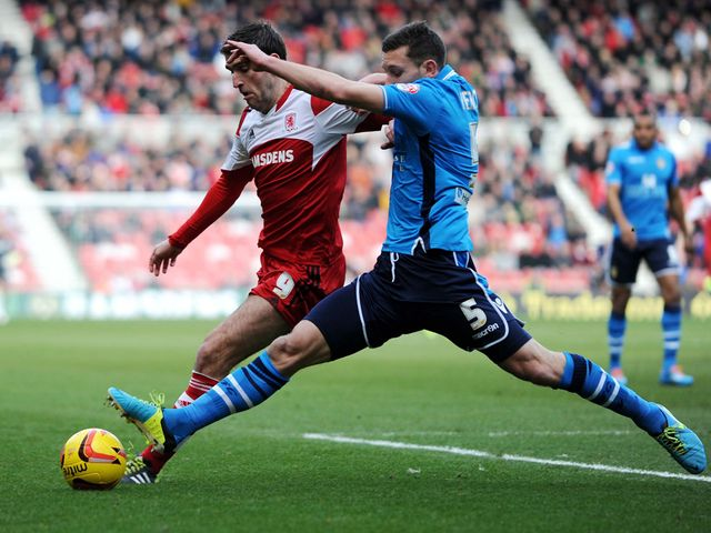 Middlesbrough's Danny Grahmam and Leeds' Jason Pearce