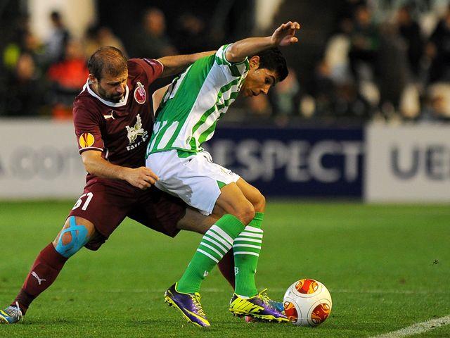 Rubin Kazan midfielder Gokdeniz vies with Betis man Juanfran