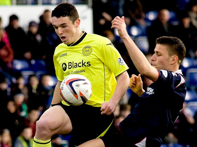 John McGinn is challenged by Filip Kiss