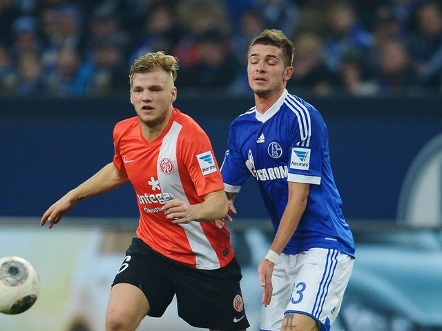 Max Meyer and Roman Neustaedter battle for the ball