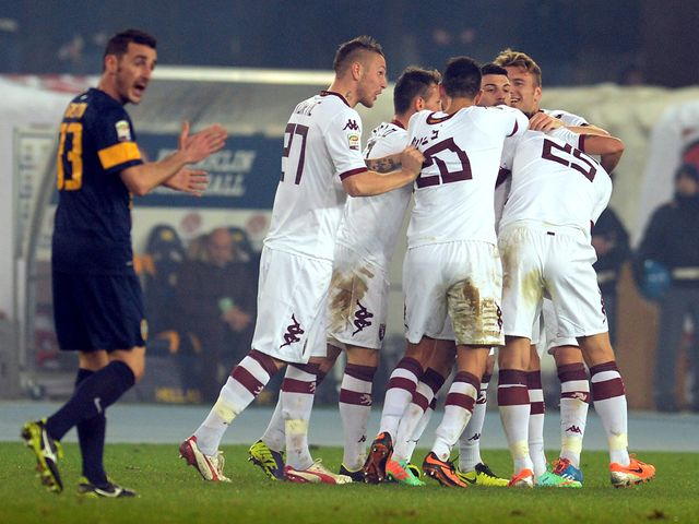 Alessio Cerci is mobbed after netting Torino's second