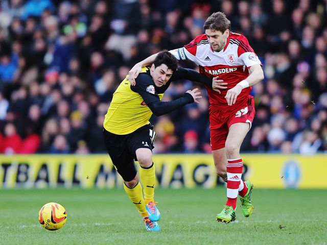 Fernando Forestieri holds off the challenge of Jonathan Woodgate