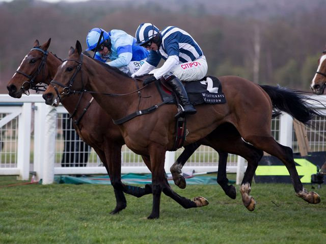 Restless Harry (far side) gets the better of a thrilling battle with the new Grand National favourite