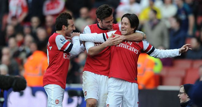 Tomas Rosicky celebrates scoring Arsenal's third goal of the day