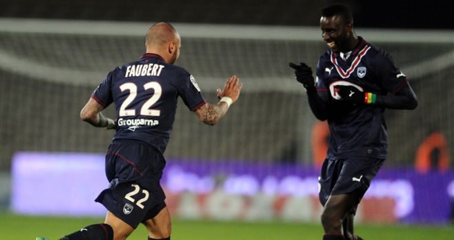 Bordeaux's midfielder Julien Faubert (left) celebrates