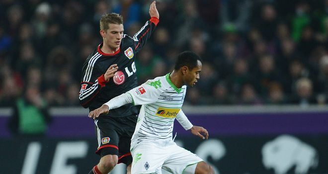 Lars Bender tries to tackle Raffael